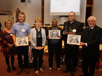 Patricia and Kevin Duffy; Presenter Nelleke Wijngards-Serrarens, Netherlands; Charles Dube, Zimbabwe; Renato Afonso Vinhal, Brazil; Bishop Gebhard Fürst, Germany